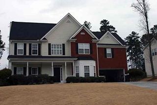 Residential 2 story home with burgundy and ivory siding